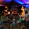 JIM VAIKNORAS/Staff photo Marina Evans fronts the Compaq Jazz Band as dancer enjoy the show Saturday night in Market Landing Park.