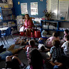 "BRYAN EATON/Staff photo. With the lights out and fans blowing, Amesbury Elementary School teacher Liz Morris reads ""First Day Jitterbugs"" to her class, the lights off having a calming-and cooling--effect."