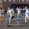 BRYAN EATON/Staff photo. Runners are a blur as they head into Market Square.