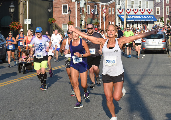 BRYAN EATON/Staff photo. One very enthusiastic runner heads into Market Square.