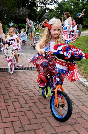 "BRYAN EATON/Staff photo. Lilly Bastien, 6, of Newton, N.H. heads out on the Kids Day in the Park Carriage and Bicycle Parade. She was the winner in the girls category with her decor ""Red, White and Blue."""