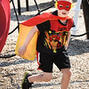 BRYAN EATON/Staff photo. Winston Brown, 6, runs an obstacle course at Amesbury Town Park dresses as Flash Gordon. It was Superhero Day at the Amesbury Youth Recreation's Summer Park Program.