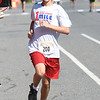JIM VAIKNORAS/Staff photo Griffin White wins the under 16 heat at the High Street Mile Sunday morning in Newburyport.