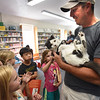 BRYAN EATON/Staff photo. Jonathan Hall, a medical first responder from Brimfield, wrote two childrens books based on his cat, Toto, who as a kitten that survived the 2011 Brimfield tornado. He was at the G.A.R. Memorial Library in West Newbury on Thursday to read to the children and introduce Toto.