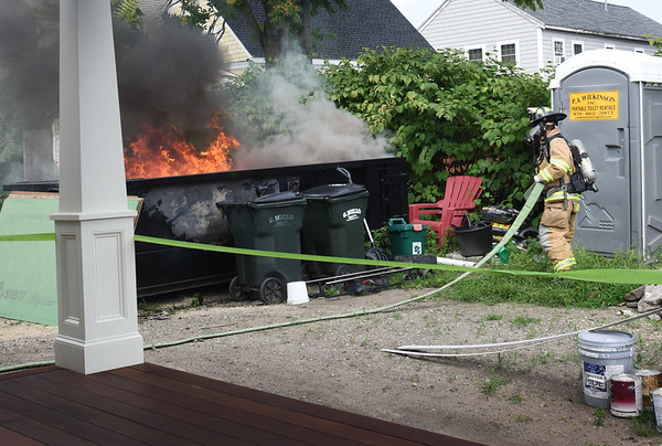 BRYAN EATON/Staff photo. Newburyport firefighters responded to a dumpster fire on Center Street on Tuesday afternoon. The adjacent house has been under renovation.