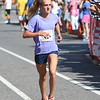 JIM VAIKNORAS/Staff photo Kate Burrus ,12 , is the first female in the under 16 heat at the High Street Mile Sunday morning in Newburyport.