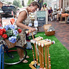 BRYAN EATON/Staff photo. Pam Shaw of Newburyport checks out items at Flukes and Finds on State Street during Sidewalk Sales.