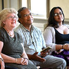 BRYAN EATON/Staff photo. Retiring head librarian at the Newburyport Public Library, Cynthia Dadd, with husband, Ramace, and  daughter, Priya, listen to several speakers talk of her over nine years at the institution.