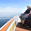 BRYAN EATON/Staff photo. Lisa Rowan of Newburyport, who is on the city disabilities commission, appreciated the calm of the ocean on this day at sea.