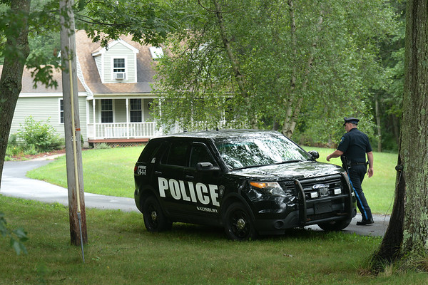 BRYAN EATON/Staff photo. Salisbury police responded to a 911 call that shots were fired at this home on High Street late Sunday night. Police found 15 shell casings on the street.