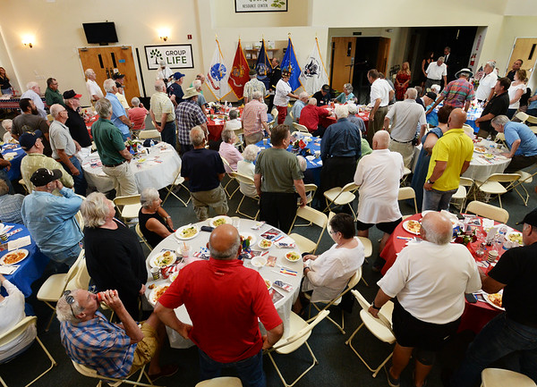 BRYAN EATON/Staff photo. Master of Ceremonies Brigadier General (Ret.) Paul G. Smith asked those to rise who were veterans at the Yankee Homecoming Veteran Luncheon.