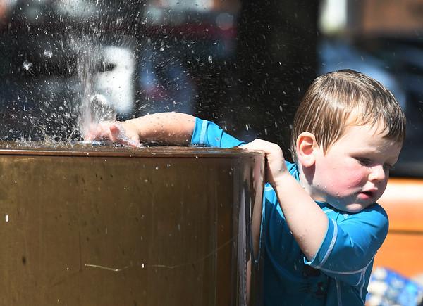 JIM VAIKNORAS/Staff photo Connor Rallins, 2, of Newburyport cools off by splashing in the fountain on Inn Street in Newburyport Wednesday.