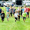 JIM VAIKNORAS/Staff photo Runners compete in the 40 yard dash at Seabrook Old Home Days Sunday at Seabrook Elementary School.