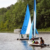 BRYAN EATON/Staff photo. Youngsters head out from Camp Kent on Lake Gardner in Amesbury during the Amesbury Youth Recreation Department's Sailing Camp which finishes on Friday. The young sailors learned rigging, reading wind direction, knot tying and chart and navigation skills.