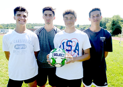 BRYAN EATON/Staff Photo. Pentucket High boys soccer captains, from left, Nick Lamattina, Jake Correnti, Dylan Buchanan and Matt Tinneo.
