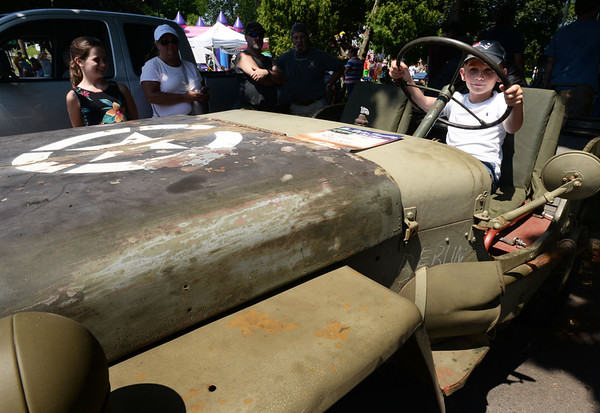 BRYAN EATON/Staff Photo. Joey Fulmer, 8, of Newburyport loves jeeps and got to sit in one at the Old Car Show at Olde Fashioned Sunday.