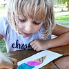 BRYAN EATON/Staff Photo. Penelope Amaral, 7, creates an ice cream cone of straberry and blueberries, her favorite, at a coloring contest at the Amesbury Parks Program on Wednesday afternoon at the Town Park. The program, run by Amesbury Youth Recreation, ends Friday for the season.