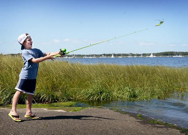 BRYAN EATON/Staff Photo. Brendan Kelley, 7, of Newburyport spends some of his last days of summer casting with new fishing gear, which got tangled a couple times, at the boat ramp at Joppa Park in Newburyport on Tuesday afternoon. After his attempts at landing the bigt one, he had to go get his haircut as the Bresnahan School student starts classes in two weeks.