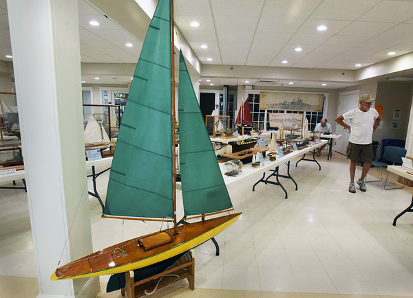 BRYAN EATON/Staff Photo. This model sailboat is being raffled off by The Merrimack Valley Ship Model Club. Their show of model shop in the basement of Unitarian Universalist Church continues until 5:00pm on Saturday.