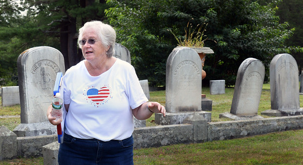 BRYAN EATON/Staff Photo. Jane Snow has been working to improve Union Cemetery in Amesbury and help categorize and mark different graves.
