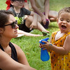 BRYAN EATON/Staff Photo. Aribelle Sweet, 20 months, sprays herself after spraying her mom, Jenna, of Salisbury. They were at Yankee Homecoming's Kids Day in the Park.