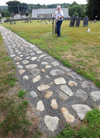 BRYAN EATON/Staff Photo. A stone path leading from the top of Union Cemetery down to the corner of Main Street and Haverhill road was discovered a couple years ago under the turf and restored.