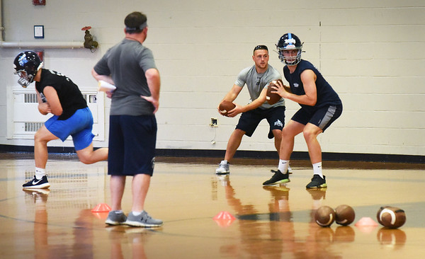 BRYAN EATON/Staff Photo. Triton High football practice was held in the gymnasium Wednesday due to the rain storm.