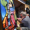 BRYAN EATON/Staff Photo. Gary Barbarti, formerly of, and returning to Newburyport from Acton, works on a piece and was one of five artists displaying their works at the artist shanties near the Custom House Maritime Museum from Thursday to Sunday. He describes his work as a cross between Picasso and psychedelic pop art artist Peter Max.