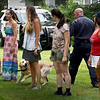 BRYAN EATON/Staff Photo. Essex County Sheriffs Department K-9 Sgt. Scott Sousa planted a scented article in the pocket of one of the volunteers which his dog, Patton, located to the cheers of the audience.
