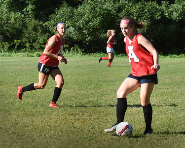 BRYAN EATON/Staff Photo. Amesbury girls soccer team in practice on Thursday afternoon.