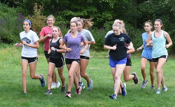 BRYAN EATON/Staff Photo. Triton girls cross country team practice.