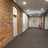 BRYAN EATON/Staff Photo. The hallway in the first grade classes at the Spalding School with the brick exposed, now house affordable housing units.