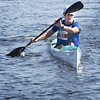 BRYAN EATON/Staff Photo. Mike McDonough of Gloucester wins in the elite kayak division.