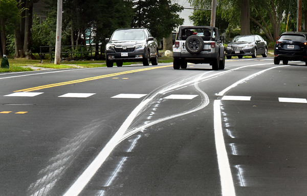 BRYAN EATON/Staff Photo. Motorists may do a double take on the new traffic lines on High Street in Newburyport which look like several vehicles went over the paint before it dried in several spots along the busy roadway.