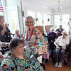 BRYAN EATON/Staff Photo. Volunteers and staff get the residents of the Brigham Manor into the swing with the Dick Kapland Excellent Jazz Band.