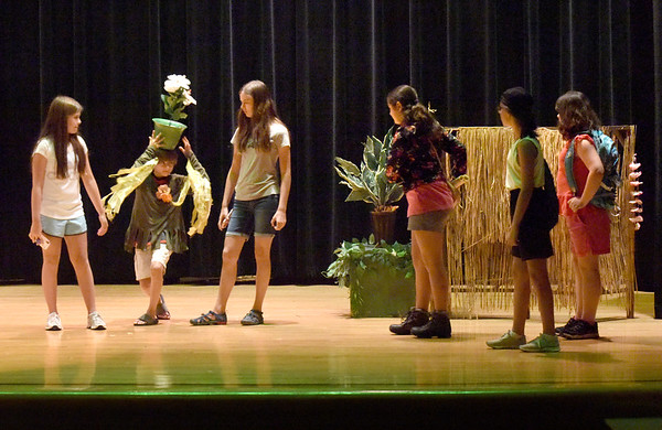 """BRYAN EATON/Staff Photo. Younsters in the Amesbury Youth Recreation's STAR Program learn all about theater, from acting, improvisation, lighting, set design and costumes. Here they practice """"Montana Jones"""" on Wednesday morning to perform for their parents tonight at Amesbury Middle School."""