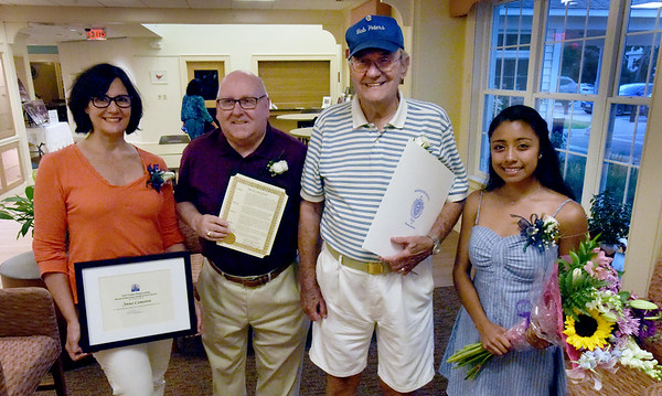 BRYAN EATON/Staff Photo. Atria Merrimack Place presented Volunteers of the Year on Wednesday night. Winners from left, standing in for Anna Cameron is her mother, Susanne, and father, Ed, out of view; Don Beaulieu; Bob Peters and Kylie Lorenzo.