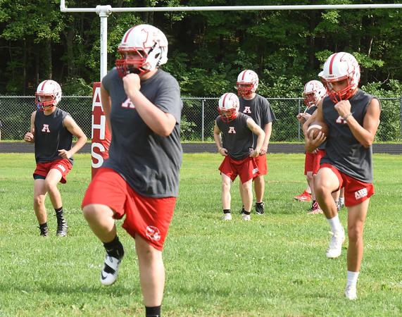 BRYAN EATON/Staff photo. Amesbury High School football team goes through drills at practice on Monday.