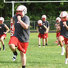 BRYAN EATON/Staff photo. Amesbury High School football team goes through drills at practice on Monday.