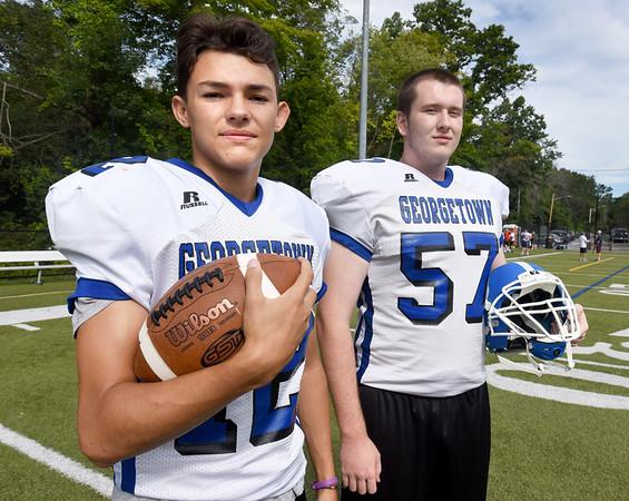 BRYAN EATON/Staff Photo. Returning quarterback Stephen MacDonald, left, and lineman Josh Kennedy.