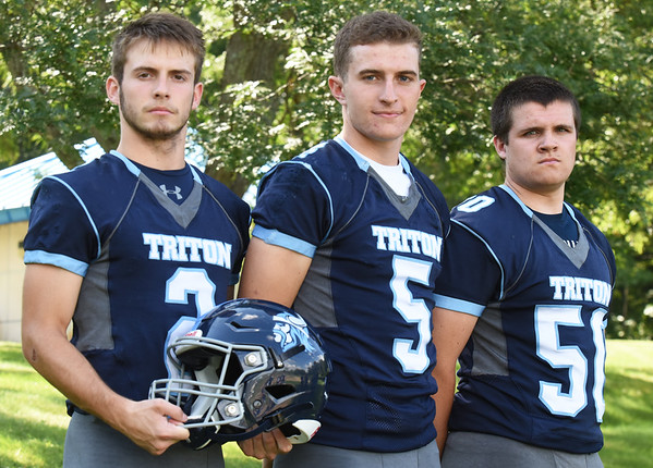 BRYAN EATON/Staff Photo. Triton football captains, from left, Ethan Tremblay, Kyle Odoy and Barry Nangle.