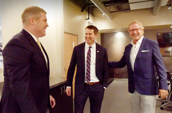 BRYAN EATON/Staff Photo. ARC Technologies founder Dan Healey, right, gave state Rep. Jim Kelcourse, left, and U.S. Rep Seth Moulton at the South Hunt Road facility in Amesbury.