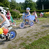 BRYAN EATON/Staff Photo. Participants in the Kids Day in the Park Carriage and Bike Parade head out to be judged.