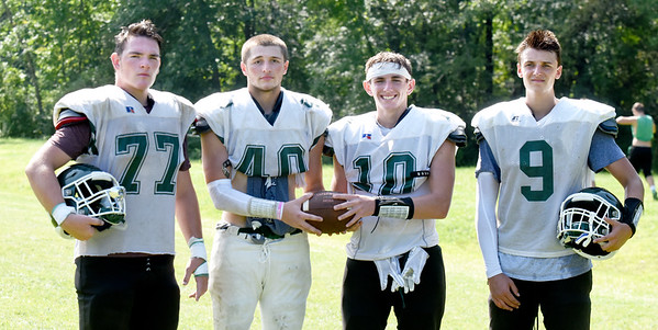 BRYAN EATON/Staff Photo. Pentucket High football captains, from left, Jacob Codair, Austin Senfleben, Jake Etter and Peter Cleary.