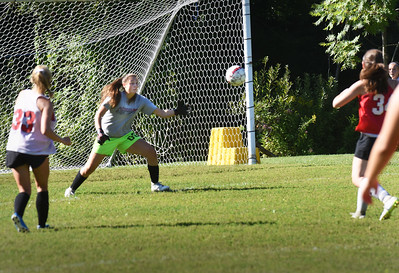 BRYAN EATON/Staff Photo. Goalie Alli  Napoli deflects the ball in practice.