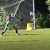 BRYAN EATON/Staff Photo. Goalie Alli  Napoli deflects the ball in practice.