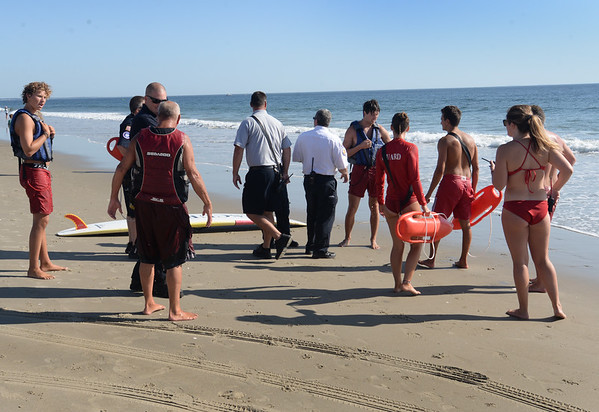 BRYAN EATON/Staff Photo. Salisbury Beach lifeguards along with the Salisbury FIre and Police Departments coordinated at mock rescue where two kayakers were to have been hit by a boat offshore. The drill was planned well in advance and had nothing to do with the overturned vessel in the Merrimack River on Saturday.