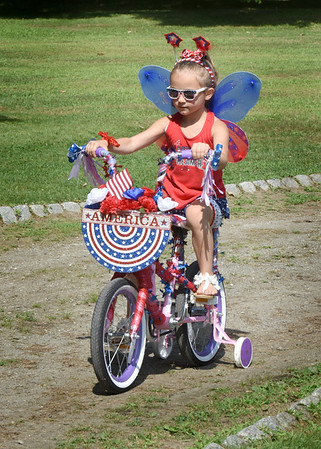 BRYAN EATON/Staff Photo. Danika Laskey, 5, of Epping, N.H., whose family is from Salisbury, was one of the patriotic contestants in the Carriage and Bike Parade at Yankee Homecoming's Kids Day in the Park sponsored by the Exchange Club of Greater Newburyport.
