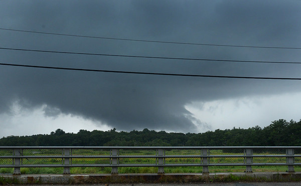 BRYAN EATON/Staff Photo. A funnel cloud is seen west in a photograph taken from the Route One bridge over the Parker River in Newbury at about 3:00 p.m. on Wednesday afternoon. The National Weather Service issued a tornado warning in the area around Groveland until 3:15 p.m.