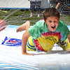 BRYAN EATON/Staff Photo. Corey Nardone, 9, of Amesbury does a little body surfing through a spray of water at the Boys and Girls Club. They were having their end of the year carnival, though the summer program closes on Friday.